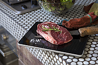Meat on digital tablet with knife - FMKYF000323