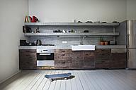 Interior of kitchen with skateboard - FMKYF000328