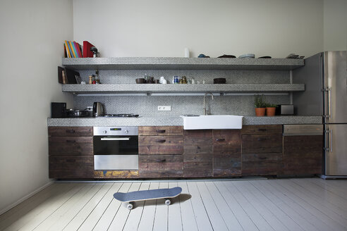 Interior of kitchen with skateboard - FMKYF000328