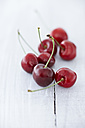 Cherries on wooden table, close up - KSW001129