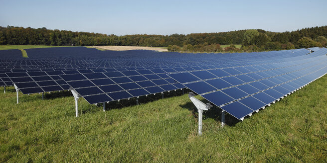 Germany, Bavaria, Solar panels on grass against sky - RDF001050
