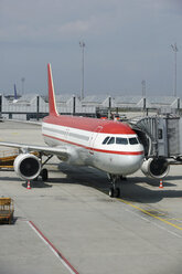 Germany, Bavaria, Munich, Aircraft A 320 on airport apron boarding - RD001098