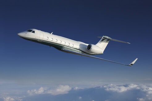 Germany, Bavaria, Munich, Businessjet flying in blue sky - RDF001100