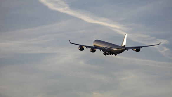 Germany, Bavaria, Munich, View of airbus a 340-600 departing at sunset - RDF001103