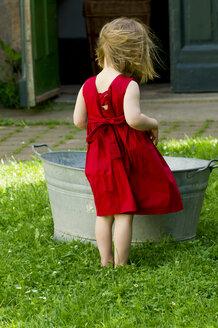 Germany, Girl standing in garden - LV000123