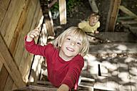 Germany, North Rhine Westphalia, Cologne, Boys playing in playground, smiling - FMKYF000415
