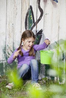 Germany, North Rhine Westphalia, Cologne, Girl playing in playground - FMKYF000388