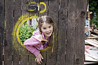 Germany, North Rhine Westphalia, Cologne, Girl playing in playground, smiling - FMKYF000377