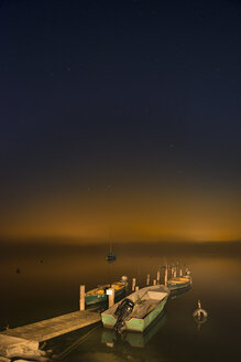 Germany, View of wooden jetty with boat in lake constance - SH000754
