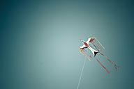 Denmark, Romo, Kite flying against sky - MJF000260
