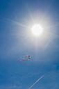 Denmark, Romo, Kite flying against sky - MJF000268