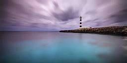 Spain, Menorca, Cap D'Artrutx, View of lighthouse at dusk - SMA000150
