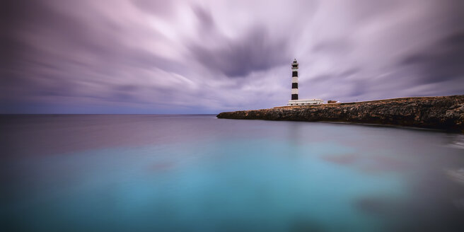 Spain, Menorca, Cap D'Artrutx, View of lighthouse at dusk - SMA000150