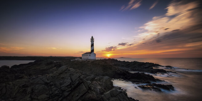 Spain, Menorca, Favaritx, View of lighthouse at sunset - SMA000138