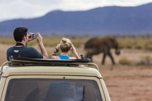 Africa,Kenya,View of Tourists taking picture of elephants at Samburu National Reserve - AM000602