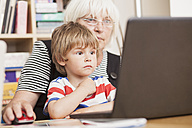 Germany, Berlin, Grandmother and grandson using laptop, close up - ZMF000002