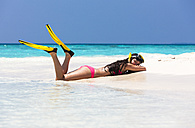 Maldives,Young woman lying in beach - AMF000634