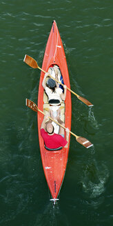 Germany, Mature men and woman on double kayak - BSC000303