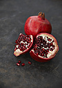 Pomegranate and seeds, close up - KSWF001160