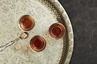 Glasses of Earl Grey tea on plate, close up - KSWF001158