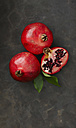 Pomegranates with leaf, close up - KSWF001152