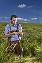 Germany, Bavaria, Farmer standing in field - MAEF006903