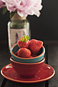Bowl of strawberries on wooden table, close up - OD000161