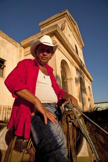 Cuba, Cowboy sitting on horse at Trinity Church - PC000008