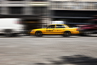 USA , New York, View of yellow taxi in motion - SKF001422