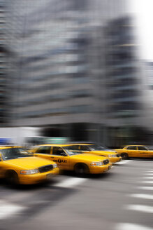 USA , New York, View of yellow taxi in motion - SKF001425