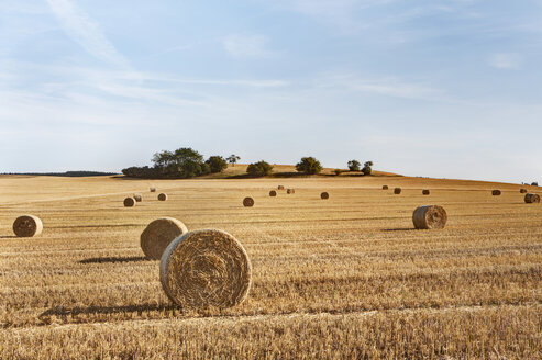 Germany, Bavaria, View of straw bales on field - SKF001347