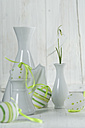Snowdrop in vase with easter eggs on wooden table, close up - ASF005029