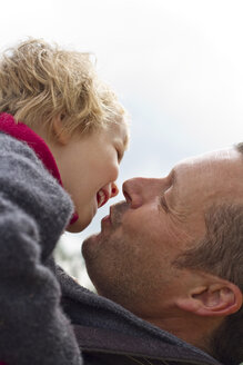 Germany, Kiel, Father kissing her daughter, close up - JFEF000138