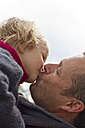 Germany, Kiel, Father kissing her daughter, close up - JFEF000139