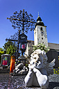 Austria, Upper Austria, Graveyard with angel figurine and Basilica Of Saint Lawrence in background - EJW000224