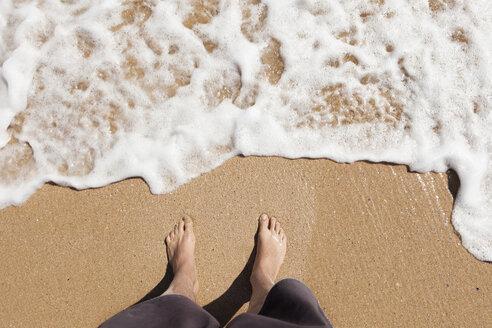 Portugal, Man standing at beach - SKF001411