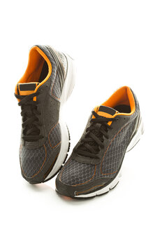 Pair of running shoes on white background, close up - MAEF006925