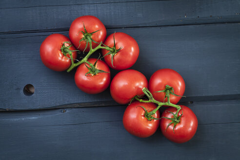 Tomatoes on wooden table, close up - ECF000262