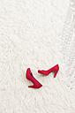 Red High Heels laying on white carpet - DRF000029