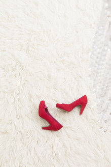 Red High Heels laying on white carpet - DRF000029