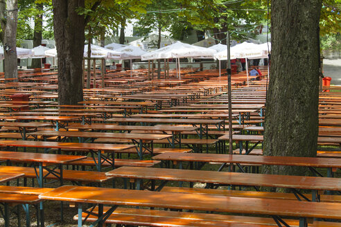 Germany, Baden Wuerttemberg, Laupheim, Empty benches and tables in beer garden - HA000165