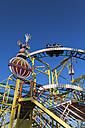 Germany, Baden Wuerttemberg, Laupheim, Roller coaster at fairground - HA000170