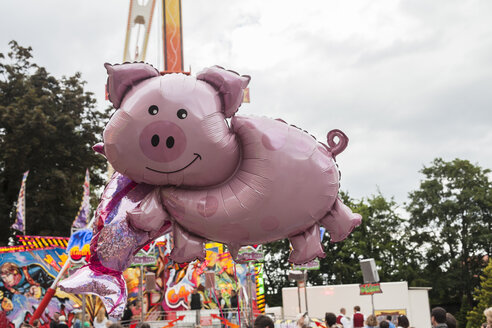 Germany, Baden Wuerttemberg, Laupheim, Pig shaped balloon at funfair - HA000173