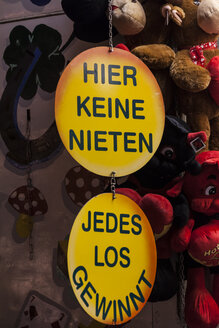 Germany, Baden Wuerttemberg, Laupheim, Sign board hanging against toys, close up - HAF000174