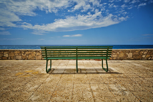 Italy, View of empty bench at beach - DIKF000040