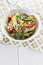 Bowl of pepper pasta with parmesan and thyme on wooden table, close up - EVGF000154