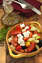 Bowl of greek salad with feta cheese and black olives on wooden table, close up - OD000258