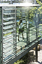 Germany, Hannover, Businesswoman walking in office - KFF000102