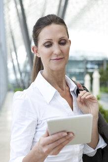Businesswoman holding digital tablet - KFF000123
