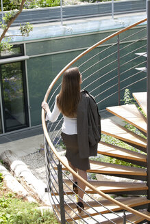 Businesswoman on spiral staircase - KFF000172